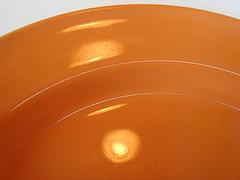 Empty orange plate