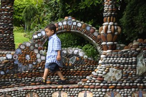 Boy walking through rock garden